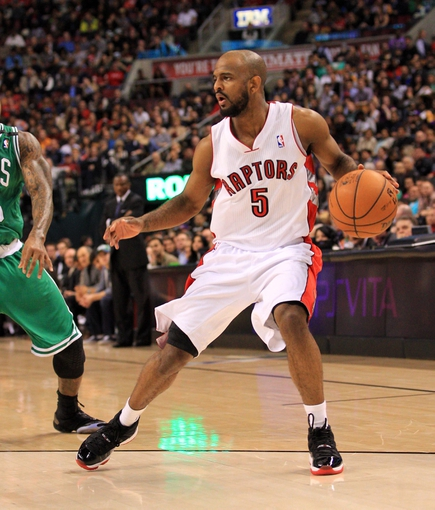 Apr 17, 2013; Toronto, Ontario, CAN; Toronto Raptors point guard John Lucas (5) takes the ball bt Boston Celtics shooting guard Terrence Williams (55) during the fourth quarter at the Air Canada Centre. The Raptors beat the Celtics 114-90. Mandatory Credit: Kevin Hoffman-USA TODAY Sports