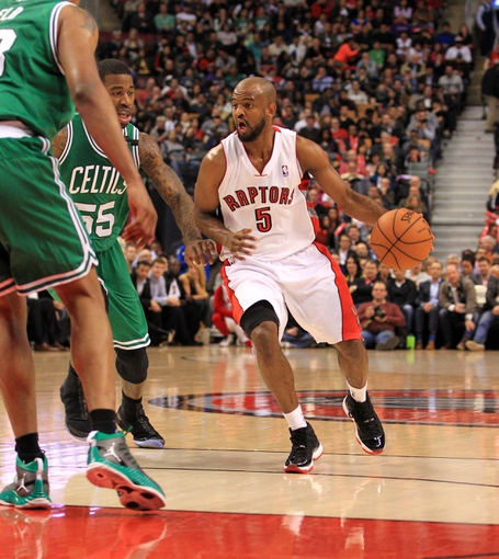 Apr 17, 2013; Toronto, Ontario, CAN; Toronto Raptors point guard John Lucas (5) dribbles around Boston Celtics shooting guard Terrence Williams (55) during the fourth quarter at the Air Canada Centre. The Raptors beat the Celtics 114-90. Mandatory Credit: Kevin Hoffman-USA TODAY Sports