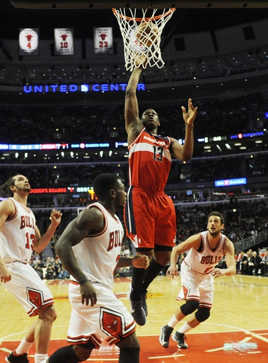 Apr 17, 2013; Chicago, IL, USA; Washington Wizards power forward Kevin Seraphin (13) shoots over Chicago Bulls point guard Nate Robinson (2) during the second half at the United Center. The Chicago Bulls defeated the Washington Wizards 95-92. Mandatory Credit: David Banks-USA TODAY Sports
