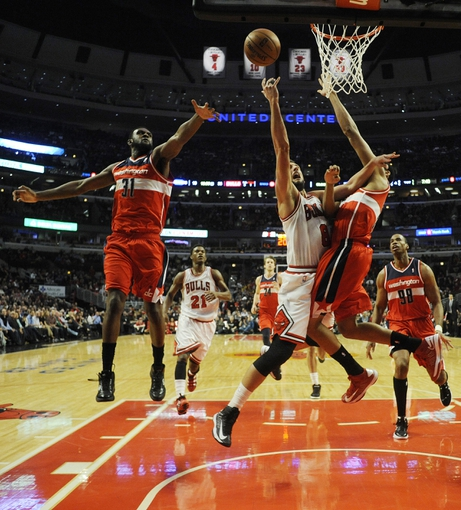 Apr 17, 2013; Chicago, IL, USA; Chicago Bulls shooting guard Marco Belinelli (8) is defended by Washington Wizards small forward Chris Singleton (31) and Washington Wizards shooting guard Garrett Temple (17) at the United Center. Mandatory Credit: David Banks-USA TODAY Sports