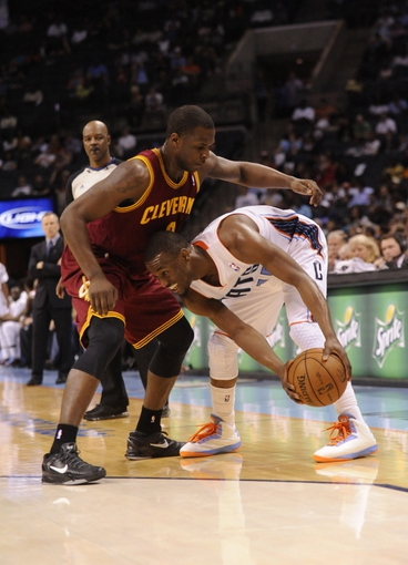 April 17, 2013; Charlotte, NC, USA; Charlotte Bobcats guard Kemba Walker (15) looks to drive past Cleveland Cavaliers guard Dion Waiters (3) Bobcats win 105-98. during the game at Time Warner Cable Arena. Mandatory Credit: Sam Sharpe-USA TODAY Sports