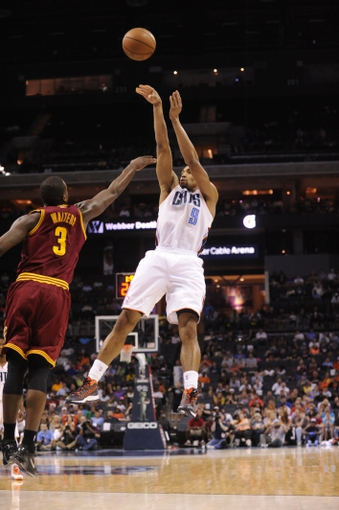 April 17, 2013; Charlotte, NC, USA; Charlotte Bobcats guard Gerald Henderson (9) shoots a jump shot as he is defended by Cleveland Cavaliers guard Dion Waiters (3) during the game at Time Warner Cable Arena. Bobcats win 105-98. Mandatory Credit: Sam Sharpe-USA TODAY Sports