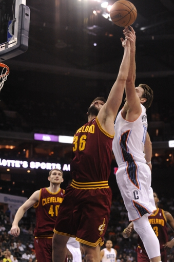 April 17, 2013; Charlotte, NC, USA; Cleveland Cavaliers forward Omri Casspi (36) and Charlotte Bobcats forward Josh McRoberts (11) fight for a rebound during the game at Time Warner Cable Arena. Bobcats win 105-98. Mandatory Credit: Sam Sharpe-USA TODAY Sports