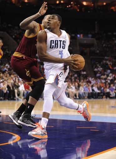 April 17, 2013; Charlotte, NC, USA; Charlotte Bobcats forward Jeff Adrien (4) drives past Cleveland Cavaliers forward Luke Walton (15) during the game at Time Warner Cable Arena. Bobcats win 105-98. Mandatory Credit: Sam Sharpe-USA TODAY Sports