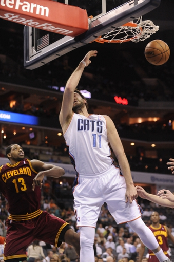 April 17, 2013; Charlotte, NC, USA; Charlotte Bobcats forward Josh McRoberts (11) dunks the ball for a score during the game against the Cleveland Cavaliers at Time Warner Cable Arena. Bobcats win 105-98. Mandatory Credit: Sam Sharpe-USA TODAY Sports