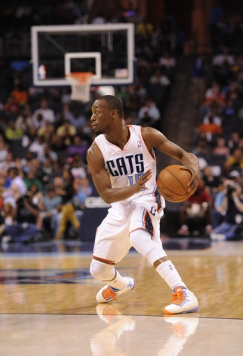 April 17, 2013; Charlotte, NC, USA; Charlotte Bobcats guard Kemba Walker (15) looks to pass during the game against the Cleveland Cavaliers at Time Warner Cable Arena. Bobcats win 105-98. Mandatory Credit: Sam Sharpe-USA TODAY Sports
