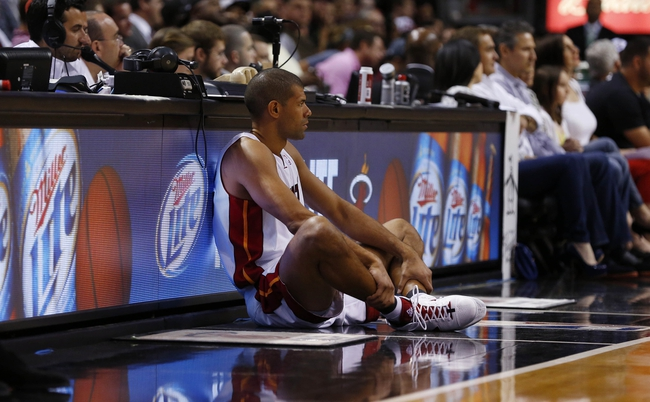 Apr 17, 2013; Miami, FL, USA;  Miami Heat small forward Shane Battier (31) waits to enter the game against the Orlando Magic in the second half at the American Airlines Arena. The Heat won 105-93.  Mandatory Credit: Robert Mayer-USA TODAY Sports