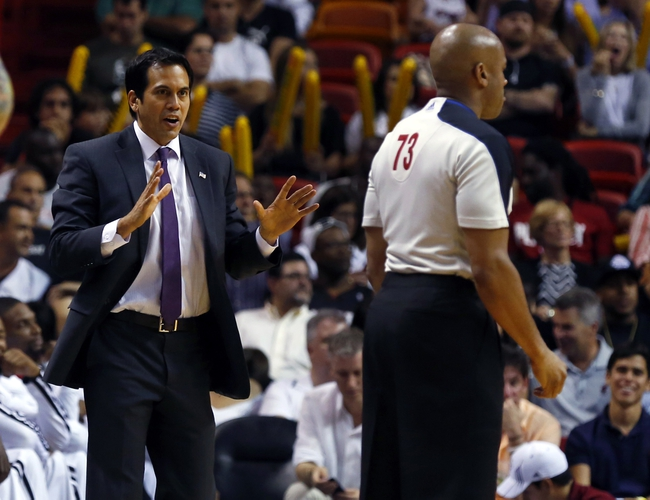 Apr 17, 2013; Miami, FL, USA;  Miami Heat head coach Erik Spoelstra talks with official Tre Maddox in the second half of a game against the Orlando Magic at the American Airlines Arena. The Heat won 105-93.  Mandatory Credit: Robert Mayer-USA TODAY Sports
