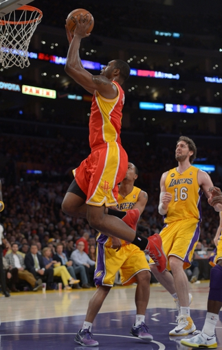 Apr 17, 2013; Los Angeles, CA, USA; Houston Rockets guard Aaron Brooks (6) is defended by Los Angeles Lakers guard Andrew Goudelock (0) and forward Pau Gasol (16) at the Staples Center. Mandatory Credit: Kirby Lee-USA TODAY Sports