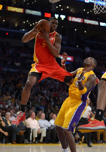 Apr 17, 2013; Los Angeles, CA, USA; Houston Rockets forward Terrence Jones (6) is defended by Los Angeles Lakers forward Antawn Jamison (4) at the Staples Center. Mandatory Credit: Kirby Lee-USA TODAY Sports