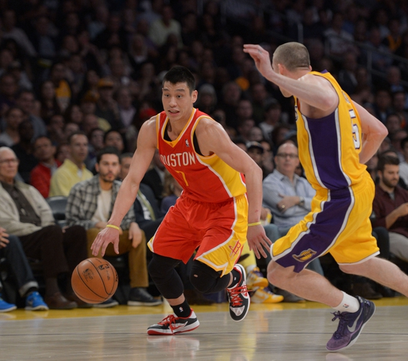 Apr 17, 2013; Los Angeles, CA, USA; Houston Rockets guard Jeremy Lin (7) is defended by Los Angeles Lakers guard Steve Blake (5)  at the Staples Center. Mandatory Credit: Kirby Lee-USA TODAY Sports