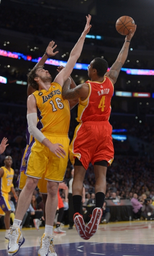 Apr 17, 2013; Los Angeles, CA, USA; Houston Rockets forward Greg Smith (4) is defended by Los Angeles Lakers forward Pau Gasol (16) and center Dwight Howard (12) at the Staples Center. Mandatory Credit: Kirby Lee-USA TODAY Sports