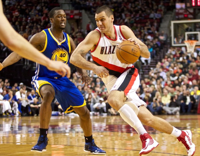April 17, 2013; Portland, OR, USA; Portland Trail Blazers shooting guard Sasha Pavlovic (3) drives to the basket against Golden State Warriors small forward Harrison Barnes (40) in the first half at the Rose Garden.  Mandatory Credit: Jaime Valdez-USA TODAY Sports