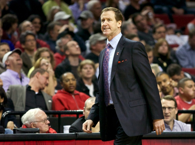 April 17, 2013; Portland, OR, USA; Portland Trail Blazers head coach Terry Stotts grimaces after a play against Golden State Warriors in the first half at the Rose Garden.  Mandatory Credit: Jaime Valdez-USA TODAY Sports