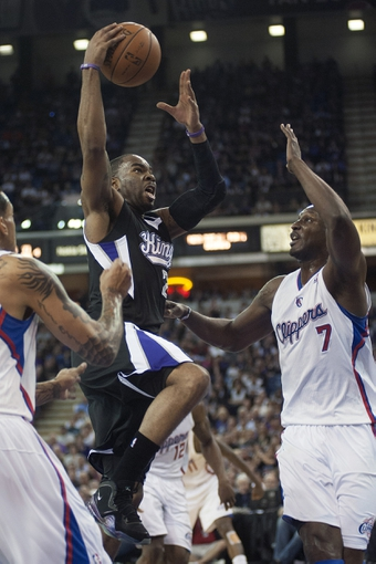 Apr 17, 2013; Sacramento, CA, USA; Sacramento Kings shooting guard Marcus Thornton (23) drives to the basket during the fourth quarter of the game against the Los Angeles Clippers at the Sleep Train Arena. The Los Angeles Clippers defeated the Sacramento Kings 112-108. Mandatory Credit: Ed Szczepanski-USA TODAY Sports
