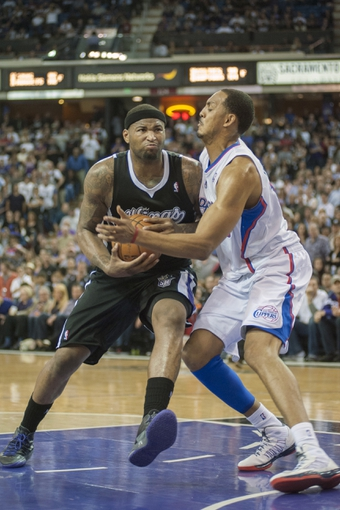 Apr 17, 2013; Sacramento, CA, USA; Sacramento Kings center DeMarcus Cousins (15) drives to the basket during the fourth quarter against the Los Angeles Clippers at the Sleep Train Arena. The Los Angeles Clippers defeated the Sacramento Kings 112-108. Mandatory Credit: Ed Szczepanski-USA TODAY Sports