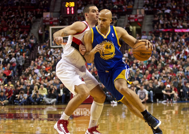 April 17, 2013; Portland, OR, USA; Golden State Warriors small forward Richard Jefferson (44) dribbles around Portland Trail Blazers shooting guard Sasha Pavlovic (3) in the second half at the Rose Garden.  Mandatory Credit: Jaime Valdez-USA TODAY Sports