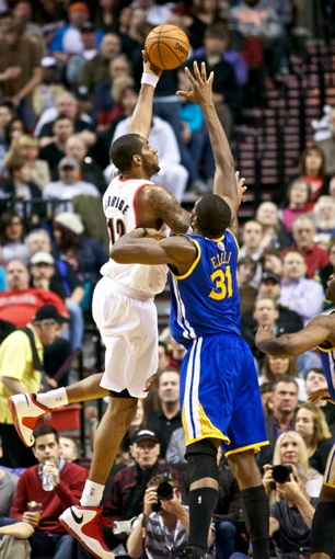 April 17, 2013; Portland, OR, USA; Portland Trail Blazers power forward LaMarcus Aldridge (12) shoots over Golden State Warriors center Festus Ezeli (31) in the second half at the Rose Garden.  Mandatory Credit: Jaime Valdez-USA TODAY Sports