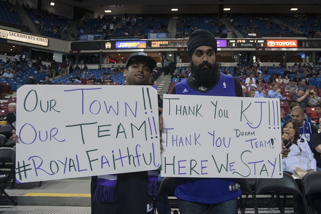 Apr 17, 2013; Sacramento, CA, USA; Sacramento Kings fans Peter Masih (left) and Bik Dosanjh (right) hold up signs before the game against the Los Angeles Clippers at the Sleep Train Arena. The Los Angeles Clippers defeated the Sacramento Kings 112-108. Mandatory Credit: Ed Szczepanski-USA TODAY Sports