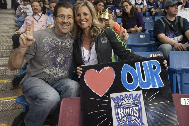 Apr 17, 2013; Sacramento, CA, USA; Sacramento Kings fans Sean Roth and Karen Roth hold up a sign before the game against the Los Angeles Clippers at the Sleep Train Arena.  The Los Angeles Clippers defeated the Sacramento Kings 112-108.Mandatory Credit: Ed Szczepanski-USA TODAY Sports