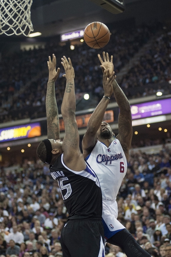 Apr 17, 2013; Sacramento, CA, USA; Los Angeles Clippers center DeAndre Jordan (6) attempts a shot over Sacramento Kings center DeMarcus Cousins (15) during the first quarter at the Sleep Train Arena. The Los Angeles Clippers defeated the Sacramento Kings 112-108. Mandatory Credit: Ed Szczepanski-USA TODAY Sports