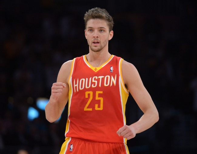 Apr 17, 2013; Los Angeles, CA, USA; Houston Rockets forward Chandler Parsons (25) celebrates after making a 3-point basket at the end of regulation to send the game against the Los Angeles Lakers into overtime at the Staples Center. The Lakers defeated the Rockets 99-95 in overtime. Mandatory Credit: Kirby Lee-USA TODAY Sports
