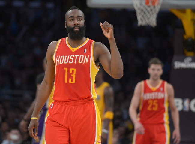 Apr 17, 2013; Los Angeles, CA, USA; Houston Rockets guard James Harden (13) celebrates during the game against the Los Angeles Lakers at the Staples Center. The Lakers defeated the Rockets 99-95 in overtime. Mandatory Credit: Kirby Lee-USA TODAY Sports