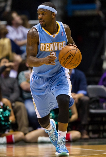 Apr 15, 2013; Milwaukee, WI, USA;  Denver Nuggets guard Ty Lawson (3) during the game against the Milwaukee Bucks at the BMO Harris Bradley Center.  Denver won 112-111.  Mandatory Credit: Jeff Hanisch-USA TODAY Sports