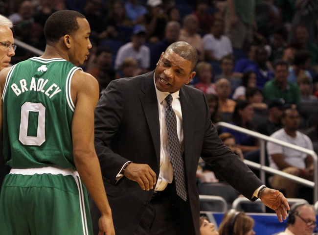 Apr 13, 2013; Orlando, FL, USA; Boston Celtics head coach Doc Rivers talks with point guard Avery Bradley (0) during the second quarter against the Orlando Magic at the Amway Center. Mandatory Credit: Kim Klement-USA TODAY Sports