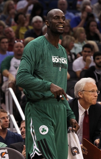 Apr 13, 2013; Orlando, FL, USA; Boston Celtics center Kevin Garnett (5) against the Orlando Magic  during the second quarter at the Amway Center. Mandatory Credit: Kim Klement-USA TODAY Sports