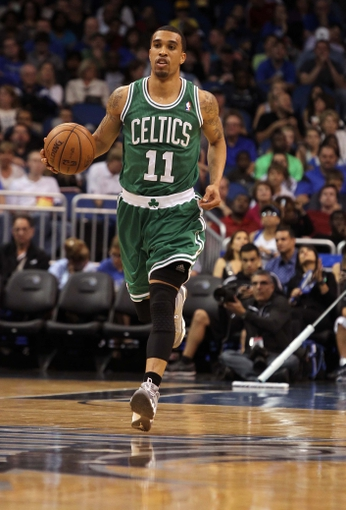 Apr 13, 2013; Orlando, FL, USA; Boston Celtics shooting guard Courtney Lee (11) dribbles the ball against the Orlando Magic during the second quarter at the Amway Center. Mandatory Credit: Kim Klement-USA TODAY Sports