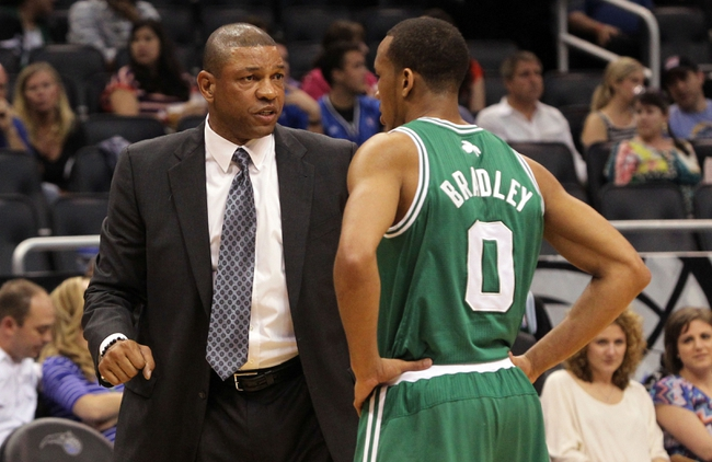 Apr 13, 2013; Orlando, FL, USA; Boston Celtics head coach Doc Rivers talks with point guard Avery Bradley (0) against the Orlando Magic during the second quarter at the Amway Center. Mandatory Credit: Kim Klement-USA TODAY Sports