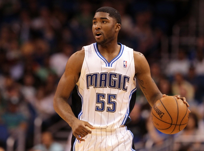 Apr 13, 2013; Orlando, FL, USA; Orlando Magic shooting guard E'Twaun Moore (55) against the Boston Celtics during the second half at the Amway Center. Boston Celtics defeated the Orlando Magic 120-88. Mandatory Credit: Kim Klement-USA TODAY Sports