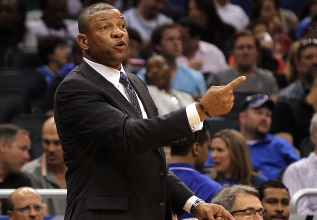 Apr 13, 2013; Orlando, FL, USA;  Boston Celtics head coach Doc Rivers calls a play against the Orlando Magic during the second half at the Amway Center. Boston Celtics defeated the Orlando Magic 120-88. Mandatory Credit: Kim Klement-USA TODAY Sports