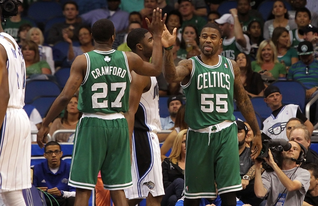 Apr 13, 2013; Orlando, FL, USA; Boston Celtics shooting guard Terrence Williams (55) high fives shooting guard Jordan Crawford (27) against the Orlando Magic during the second half at the Amway Center. Boston Celtics defeated the Orlando Magic 120-88. Mandatory Credit: Kim Klement-USA TODAY Sports