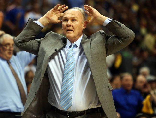 Apr 20, 2013; Denver, CO, USA; Denver Nuggets head coach George Karl reacts during the second half of game one of the first round of the 2013 NBA Playoffs against the Denver Nuggets at the Pepsi Center. The Nuggets won97-95.  Mandatory Credit: Chris Humphreys-USA TODAY Sports