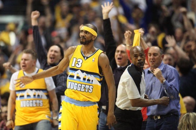 Apr 20, 2013; Denver, CO, USA; Denver Nuggets forward Corey Brewer (13) reacts after hitting a three point basket during the second half of game one of the first round of the 2013 NBA Playoffs against the Golden State Warriors at the Pepsi Center. The Nuggets won 97-95.  Mandatory Credit: Chris Humphreys-USA TODAY Sports