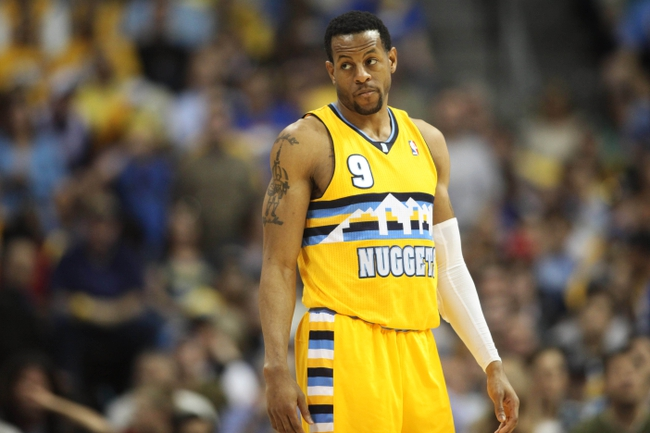 Apr 20, 2013; Denver, CO, USA; Denver Nuggets guard Andre Iguodala (9) reacts during the second half of game one of the first round of the 2013 NBA Playoffs against the Golden State Warriors at the Pepsi Center. The Nuggets won 97-95.  Mandatory Credit: Chris Humphreys-USA TODAY Sports
