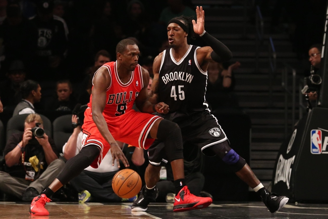 Apr 20, 2013; Brooklyn, NY, USA;  Brooklyn Nets small forward Gerald Wallace (45) defends Chicago Bulls small forward Luol Deng (9) during the third quarter of game one of the first round of the 2013 NBA Playoffs at the Barclays Center. Brooklyn won106-89.  Mandatory Credit: Anthony Gruppuso-USA TODAY Sports