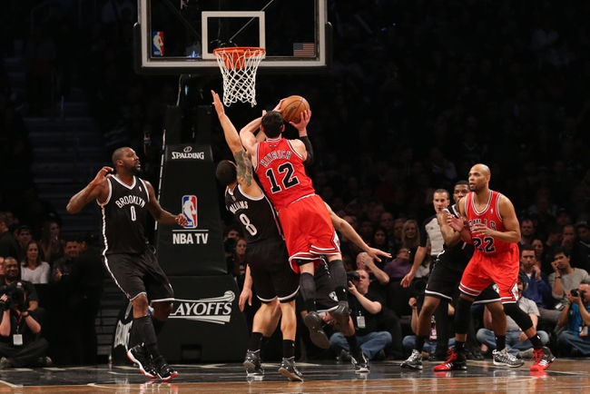 Apr 20, 2013; Brooklyn, NY, USA;  Brooklyn Nets point guard Deron Williams (8) fouls Chicago Bulls shooting guard Kirk Hinrich (12) during the third quarter of game one of the first round of the 2013 NBA Playoffs at the Barclays Center. Brooklyn won106-89.  Mandatory Credit: Anthony Gruppuso-USA TODAY Sports