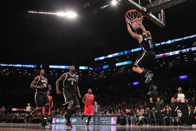 Apr 20, 2013; Brooklyn, NY, USA;  Brooklyn Nets point guard Deron Williams (8) reverse dunks during the third quarter against the Chicago Bulls in game one of the first round of the 2013 NBA Playoffs at the Barclays Center. Brooklyn won106-89.  Mandatory Credit: Anthony Gruppuso-USA TODAY Sports