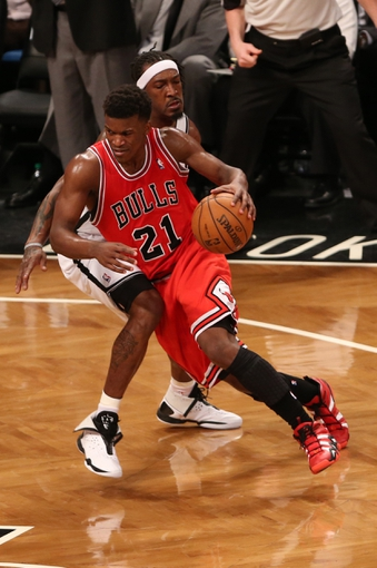 Apr 22, 2013; Brooklyn, NY, USA;  Chicago Bulls small forward Jimmy Butler (21) drives past Brooklyn Nets small forward Gerald Wallace (45) during the third quarter of game two in the first round of the 2013 NBA playoffs at the Barclays Center. Chicago won 90-82.  Mandatory Credit: Anthony Gruppuso-USA TODAY Sports