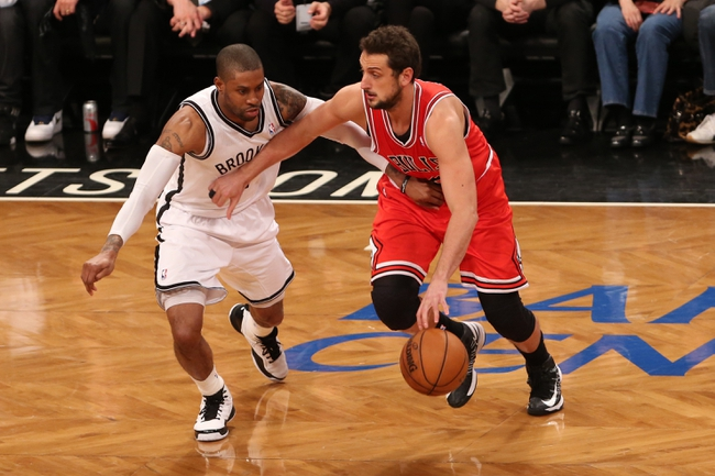 Apr 22, 2013; Brooklyn, NY, USA;  Chicago Bulls shooting guard Marco Belinelli (right) drives around Brooklyn Nets point guard C.J. Watson (1) during the third quarter of game two in the first round of the 2013 NBA playoffs at the Barclays Center. Chicago won 90-82.  Mandatory Credit: Anthony Gruppuso-USA TODAY Sports