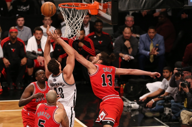 Apr 22, 2013; Brooklyn, NY, USA; Chicago Bulls center Joakim Noah (13) defends against Brooklyn Nets power forward Kris Humphries (43) during the fourth quarter of game two in the first round of the 2013 NBA playoffs at the Barclays Center. Chicago won 90-82.  Mandatory Credit: Anthony Gruppuso-USA TODAY Sports