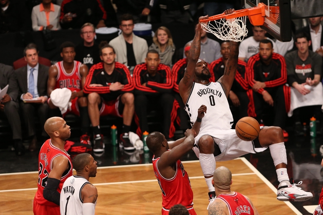Apr 22, 2013; Brooklyn, NY, USA;  Brooklyn Nets center Andray Blatche (0) dunks during the fourth quarter against the Chicago Bulls in game two in the first round of the 2013 NBA playoffs at the Barclays Center. Chicago won 90-82.  Mandatory Credit: Anthony Gruppuso-USA TODAY Sports