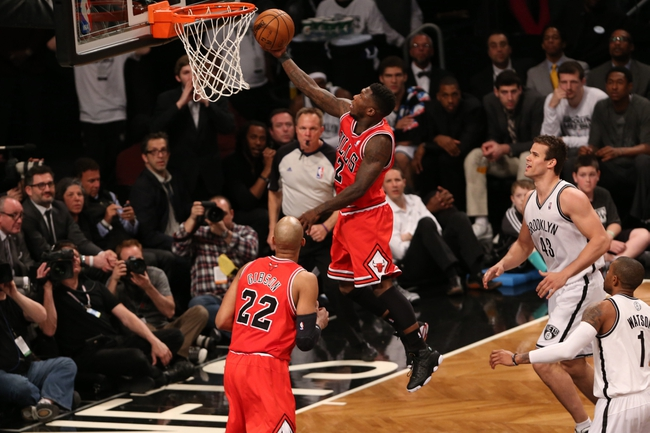 Apr 22, 2013; Brooklyn, NY, USA;  Chicago Bulls point guard Nate Robinson (2) drives up to the net during the fourth quarter against the Brooklyn Nets in game two in the first round of the 2013 NBA playoffs at the Barclays Center. Chicago won 90-82.  Mandatory Credit: Anthony Gruppuso-USA TODAY Sports