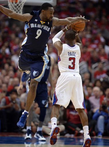 Apr 22, 2013; Los Angeles, CA, USA;  Memphis Grizzlies shooting guard Tony Allen (9) leaps in the air to defend a shot by Los Angeles Clippers point guard Chris Paul (3) in the first half of game two in the first round of the 2013 NBA playoffs at the Staples Center. Mandatory Credit: Jayne Kamin-Oncea-USA TODAY Sports
