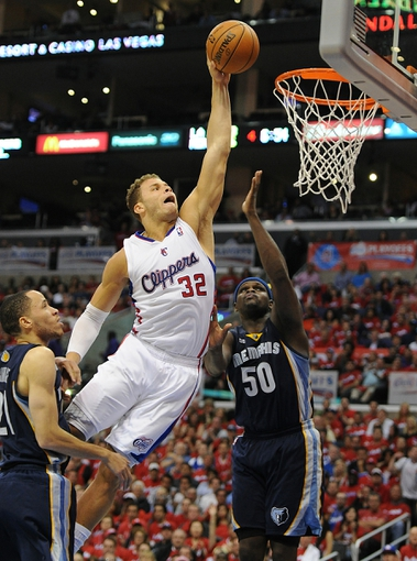 Apr 22, 2013; Los Angeles, CA, USA;  Los Angeles Clippers power forward Blake Griffin (32) dunks over Memphis Grizzlies power forward Zach Randolph (50) in the second half of game one in the first round of the 2013 NBA playoffs at the Staples Center. Clippers won 93-91. Mandatory Credit: Jayne Kamin-Oncea-USA TODAY Sports