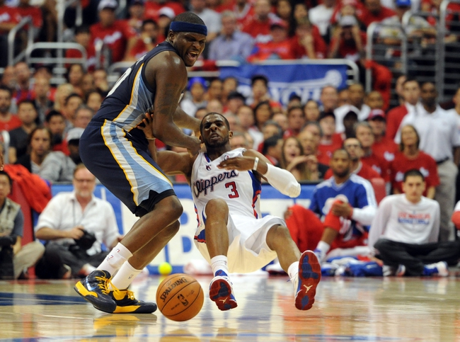 Apr 22, 2013; Los Angeles, CA, USA;   Los Angeles Clippers point guard Chris Paul (3) is fouled by Memphis Grizzlies power forward Zach Randolph (50) in the second half of game one in the first round of the 2013 NBA playoffs at the Staples Center. Clippers won 93-91. Mandatory Credit: Jayne Kamin-Oncea-USA TODAY Sports