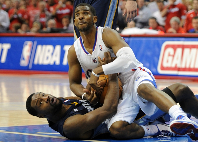 Apr 22, 2013; Los Angeles, CA, USA;   Memphis Grizzlies shooting guard Tony Allen (9) and Los Angeles Clippers point guard Chris Paul (3) fight for a loose ball in the second half of game one in the first round of the 2013 NBA playoffs at the Staples Center. Clippers won 93-91. Mandatory Credit: Jayne Kamin-Oncea-USA TODAY Sports